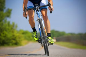 Man cycling on sports bike